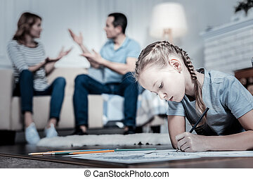 Stressed child drawing a picture