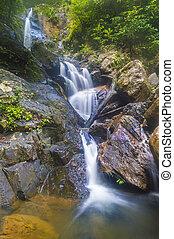 Deep forest waterfall at Kenyir lake, Malaysia
