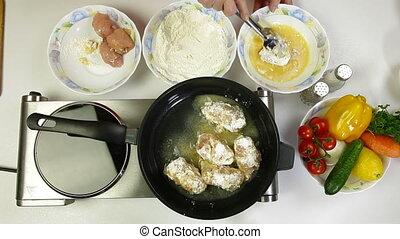 Deep Fried Chicken Breast Rolls - Female frying chicken...