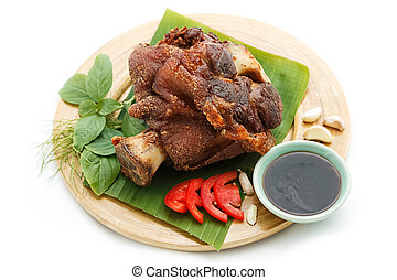 Deep Fried Pork Knuckle serve with vegetable and sauce