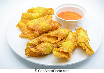 Deep Fried Won ton on white plate with dip source