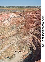 deep mine hole in rock strata - very deep mine with layers ...