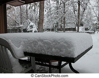 Deep Snow on Table - A picnic table is buried under about 8...