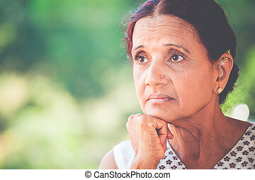Deep thinker - Closeup portrait, morose elderly lady,...