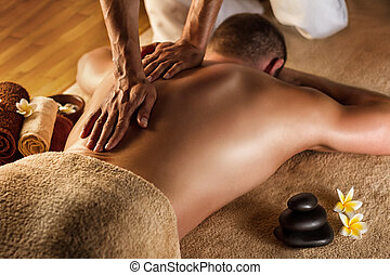 Deep tissue massage. - Man has deep tissue massage on the...