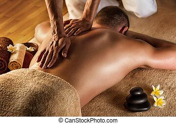 Deep tissue massage. - Man has deep tissue massage on the ...
