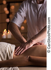 Physical therapist doing deep tissue mobilization on woman