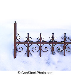 deep winter - old rusty fence in the snow