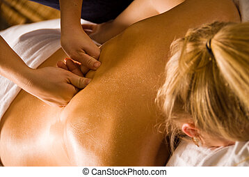 Deep work - woman at a day spa getting a deep tissue massage