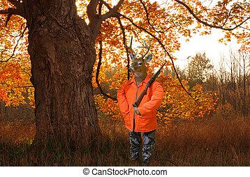 Deer Hunter - Deer dressed as a hunter in the autumn woods.
