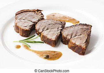 Deer meat - Roasted deer meat sliced close up shoot