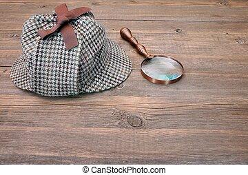 Deerstalker or Sherlock Hat and magnifying glass