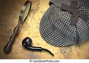 Deerstalker Sherlock Holmes Hat, Magnifier And Smoking Pipe On Map.