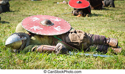 Defeated warrior lying down