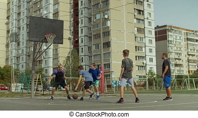 Defender committing a foul during streetball game - Sporty...