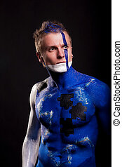 defender - handsome caucasian man with body-art mozaic...