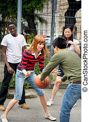 Friends playing streetball