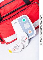 Defibrillator in first aid kit - Closeup of defibrillator in...