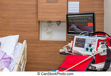 Defibrillator in ICU room at hospital with medical equipments