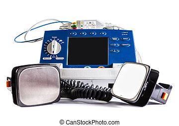 Defibrillator - a defribillator unit isolated over a white...