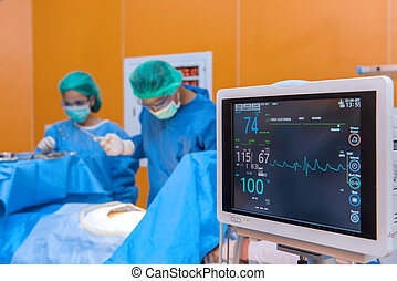 Defibrillator with Medical physician doctor or Surgery team in ICU operation room at hospital