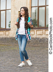 Definitely a girl. Fashion look of child girl. Little girl back to school. Informal and non-formal education. Afterschool time. Casual style trends. Kids wardrobe. Hair salon. Beauty for tomorrow