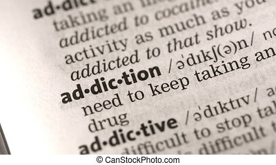 Definition of addiction highlighted in the dictionary