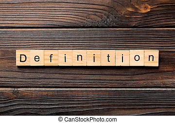 Definition word written on wood block. Definition text on wooden table for your desing, concept