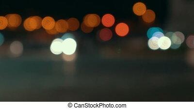 Defocus of city traffic at night