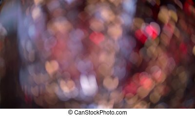 Defocus spots of lights in the shape of hearts under the christmas tinsel. Bokeh background