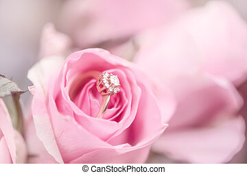 diamond engagement ring into a pink rose