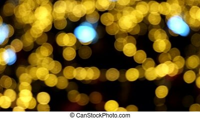Defocused abstract background of a spinning christmas tree and bokeh lights