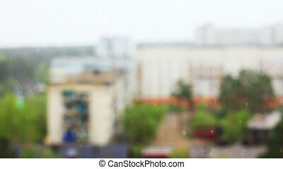 Defocused abstract background snow of summer, footage  taken in siberian city