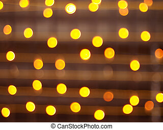 Defocused and blur image of yellow round light bulb