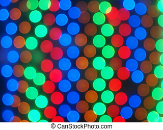 Defocused and blurry image of multicolored lights