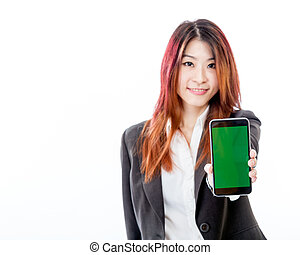 Defocused Asian woman holding out smartphone with green screen