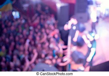 Defocused audience at the concert