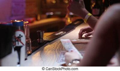 defocused bartender open can of beer