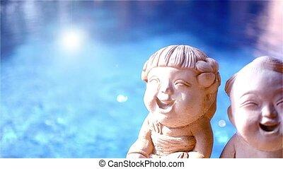 Defocused blue water in the swimming pool. Buddist's...