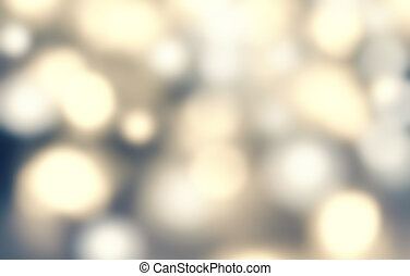 Defocused Bokeh twinkling lights - Glitter Abstract circular bokeh background of Christmas light. Gold, silver, yellow and grey. Vintage background.