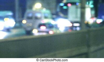 Defocused Cars on bridge. Blurred night traffic in city