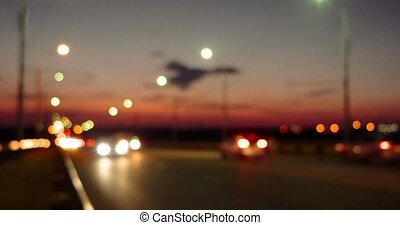 Defocused cars on motorway in sunset time