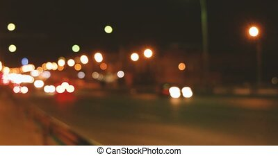 Defocused cars rushing on overpass in the night time