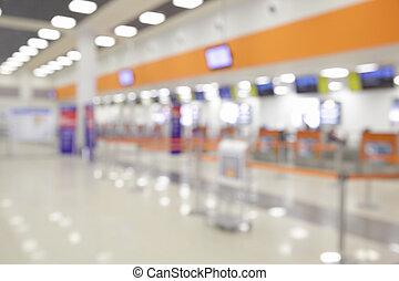 Defocused check-in counters in airport - bokeh background