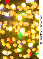 defocused christmas tree lights in a city background