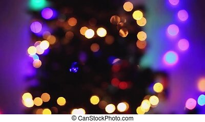 Defocused christmas tree lights with Colorful bokeh. Beautiful abstract background. 1920x1080