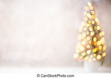 Defocused christmas tree silhouette with blurred lights.