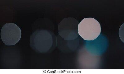 Defocused city lights in the night 4K