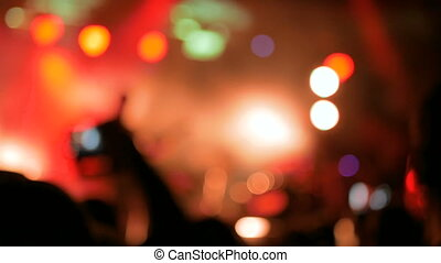 Defocused concert lighting - Abstract defocused red concert...