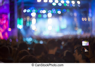 defocused crowd of people at a night concert or show